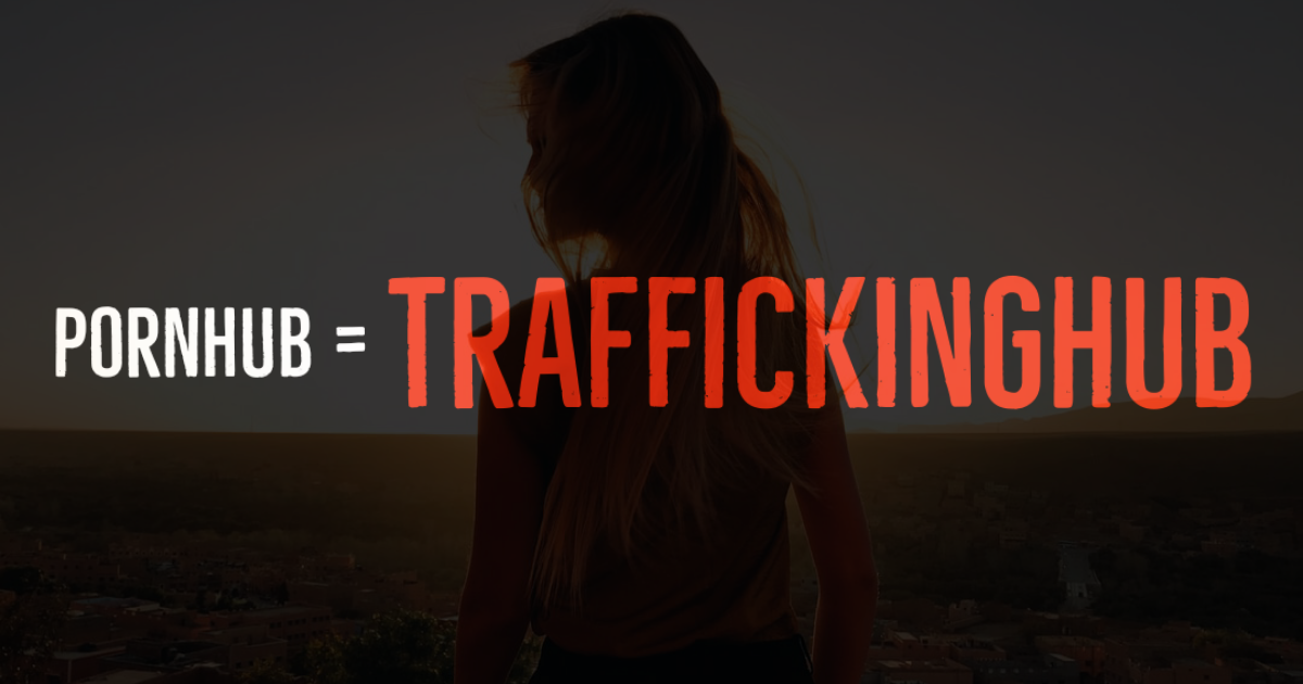 Pornhub = #TraffickingHub superimposed over an image of a woman standing outside
