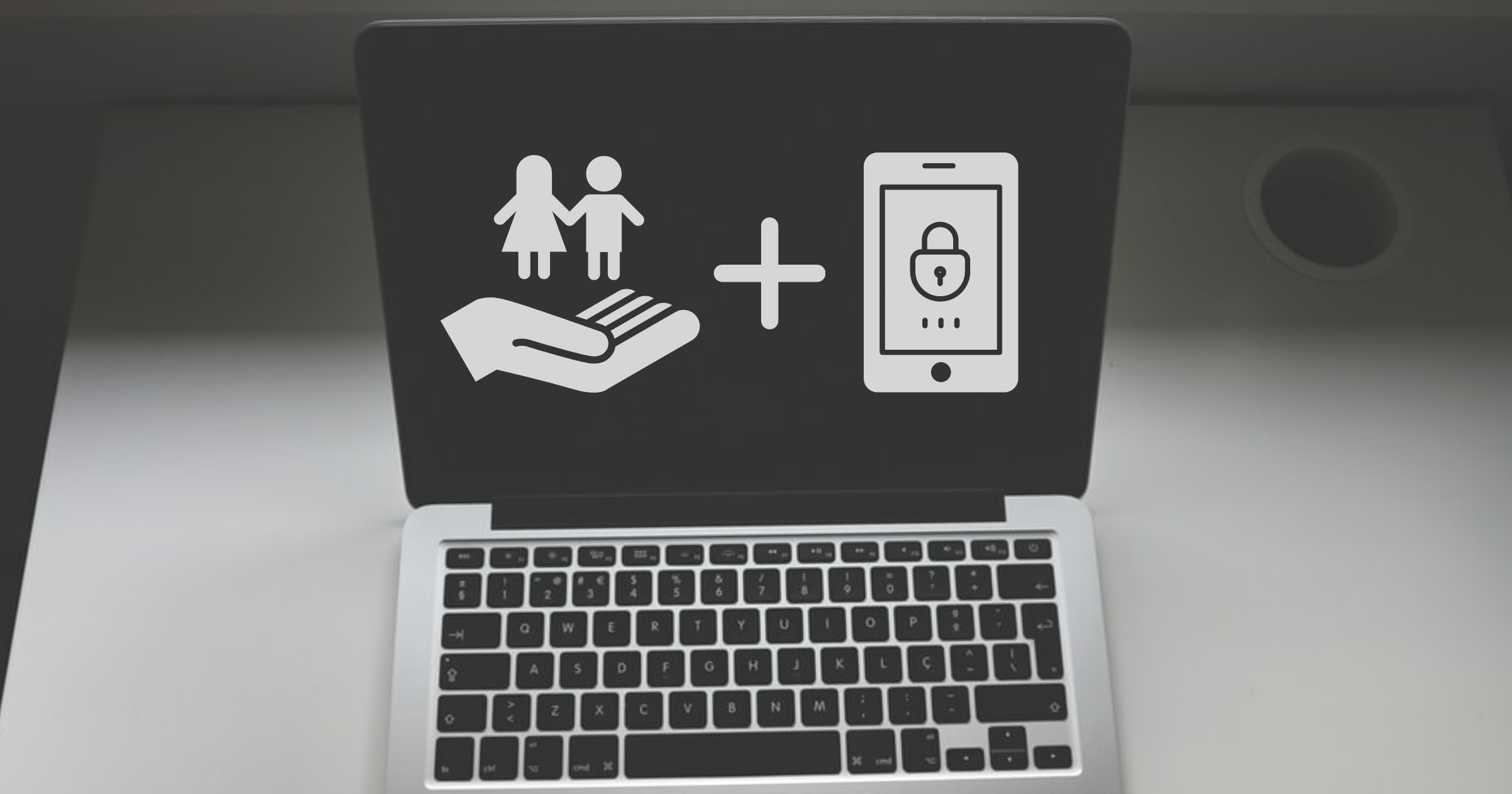 Laptop with an icon representing online child safety and a second icon representing user privacy and encryption underscores how the EARN IT Act can protect both